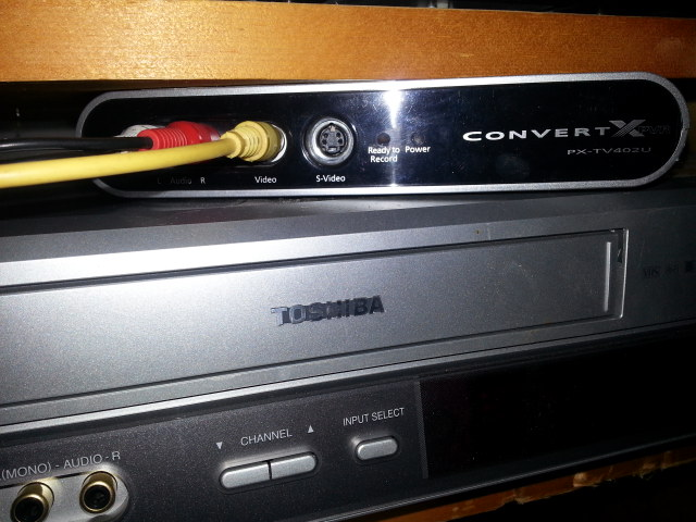 VHS Tapes and Plextor video recorder.